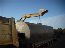 10,000 Gallon tank being safely transported for disposal