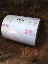 New Granby 500 gallon in ground oil tank installed in site of previous tank.